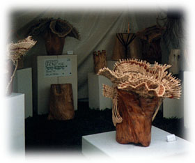 Wood sculpture and woven vessel by Jerry and Joanna