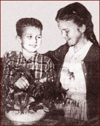 Artist Jerry Haggerty as a child, with his sister Dorothy and the fower arrangement that won him first prize